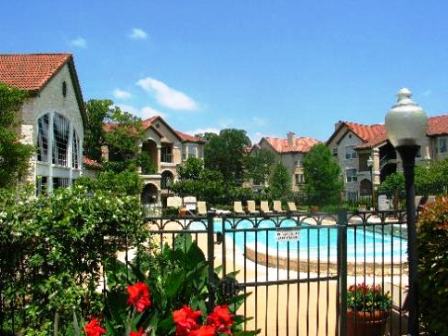 Exterior Pool View at these Austin Town Lake Apartments