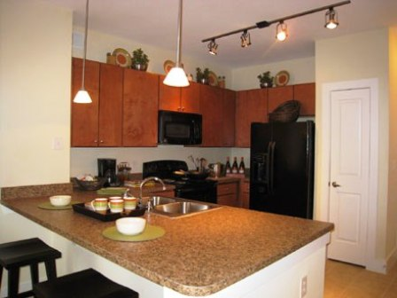 Open Kitchen with Island at these Cypress Apartments