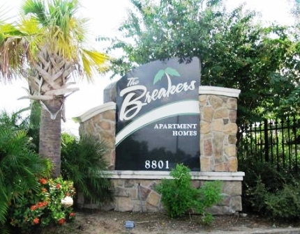 Entrance Sign to The Breakers Apartments